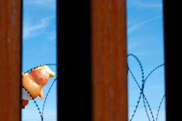 "A ""Baby Trump"" balloon floating during a protest against U.S. President Donald Trump visit to Calexico, California, as seen from Mexicali"