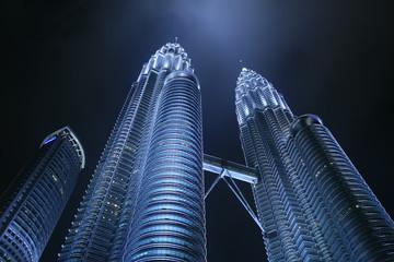 Low angle view of the Petronas Twin Towers at night, Kuala Lumpur, Malaysia