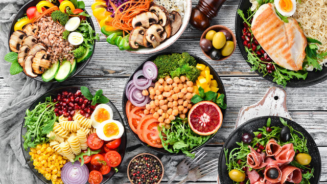 Buddha bowl on a white wooden background. Assortment of healthy food. Top view. Free space for your text.