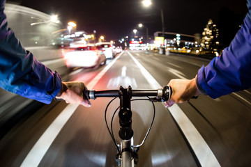 Cyclist drives on the bike path past the traffic jam - First-person view of cyclist