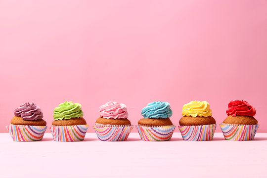 delicious cupcakes on a colored background. Festive background, birthday