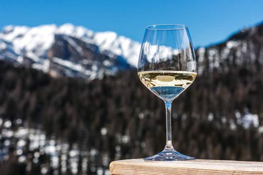 A glass of white sparkling Prosecco wine in a lodge in Cortina d'Ampezzo, Dolomites, Italy