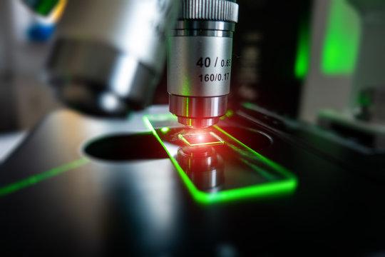 Microscope with microscope slide closeup