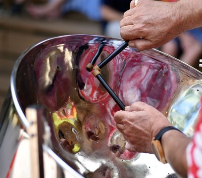 Caribbean Steel pan drum player with sticks
