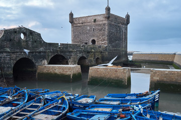 Blue boats moored at old building