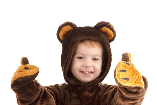 Child in a christmas carnival bear costume isolated on white with copy space,  carnival.