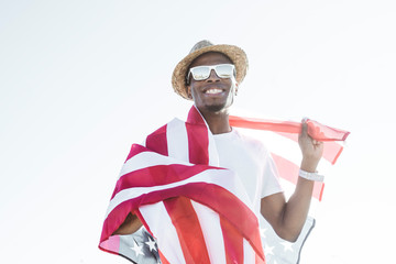 Cheerful black man with American flag
