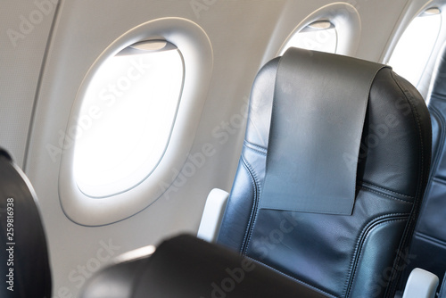 Airplane window seat with isolated white window inside the