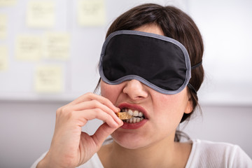 Blindfolded Young Woman Testing Food