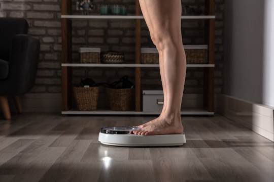 Human Foot On Weighing Scale