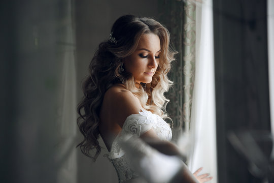 Bride's morning at the hotel.The bride before the wedding preparation.Beautiful bride