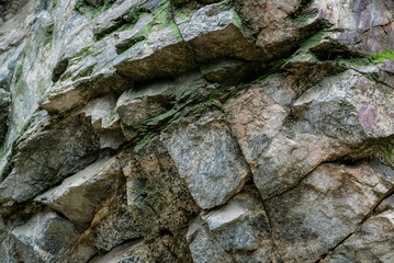Detail of moss-covered rocks with sharp angles on mountain