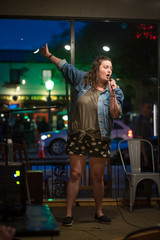 Talented female comedian performs her stand up at a local night spot open mic in Escondido, California