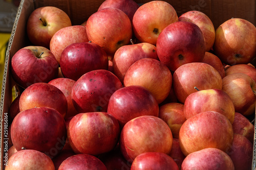 Group of fresh red apples available for sale at a street