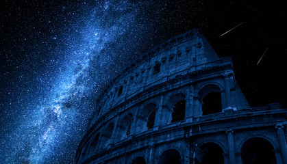 Fototapete - Milky way over Colosseum in Rome, Italy