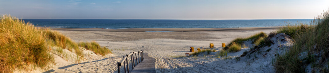 Beach on the East Frisian Island Juist in the North Sea, Germany, in morning light. Wall mural