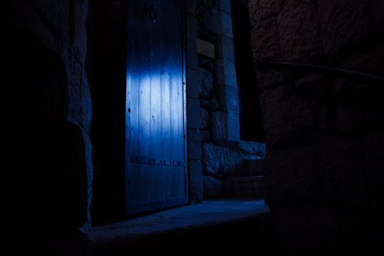 horror atmosphere interior of medieval church place inside with mystic door in blue lighting in darkness environment
