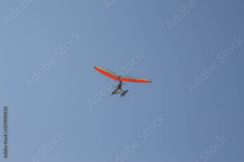 Delta wing with engine flies by the blue sky