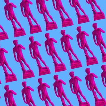 Pattern of pink neon Davids,  masterpiece of Renaissance sculpture created  by Michelangelo. Vaporwave style. Blue background
