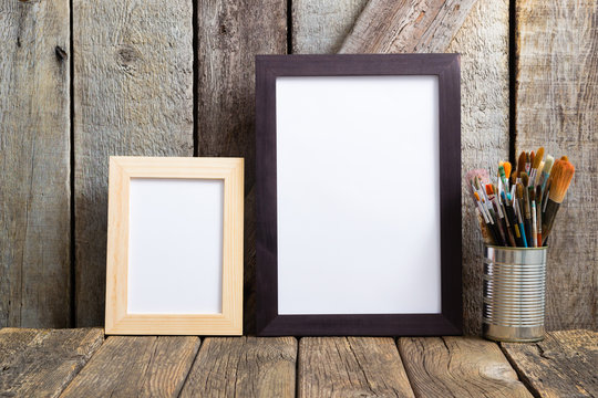 picture frame blank paper and paintbrushes at tin can