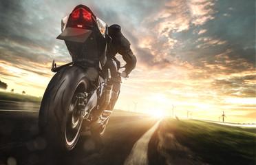 Motorrad bei voller fahrt auf einer Landstraße Wall mural