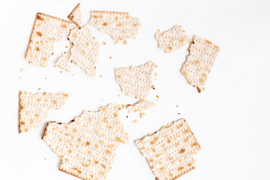 Broken pieces of matzah or matza on white isolated background. Can be used as an element for your design