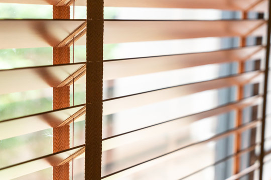Wooden shutters on the window in the living room