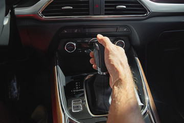 Men handle hold to gear stick lever, Start driving vehicles.On a hot day.