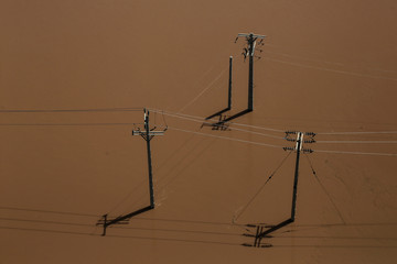 An aerial view showing electricity poles half-submerged in flood in Khuzestan province