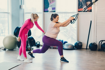 Fitness instructor trains fat woman