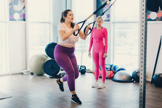 Fat woman works out in gym to lose weight