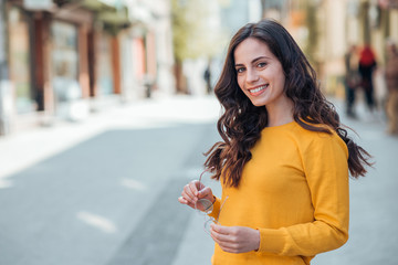 Urban portrait of a beautiful smiling young woman.