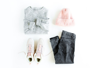 Wall Mural - Women fashion clothes and accessories. Feminine youth collage on white background top view. Flat lay female style look with warm sweater, jeans, hat, sneakers, glasses. Top view.