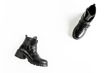 Wall Mural - Black female boots on white  background. Flat lay, top view minimal background. Fashion blog or magazine concept.