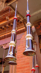 Tibetan horn hanging from the ceiling in front of a music store in Bhaktapur, Nepal
