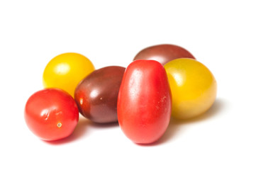group of various tomatoes en white background