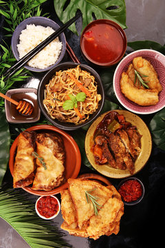 Assorted Chinese food set. Chinese noodles, fried rice, peking duck, dim sum, spring rolls. Famous Chinese cuisine dishes on table. Chinese restaurant concept.