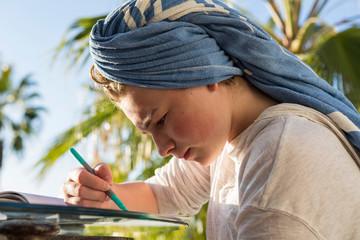 12 year old girl drawing at sunset, Todos Santos, Mexico