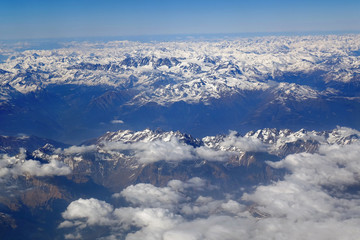 Alps mountains in spring, Italy. Aerial view from air plane