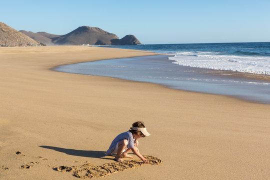 children playing on the beach, Todos Santos, Mexico