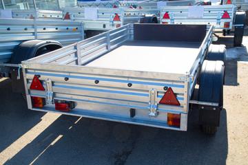 Open car trailer,ow; cargo; car trailer; trailer truck; tow bar.