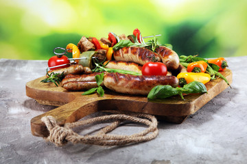 Assorted delicious grilled meat with vegetable on a barbecue. Grilled pork shish or kebab on...