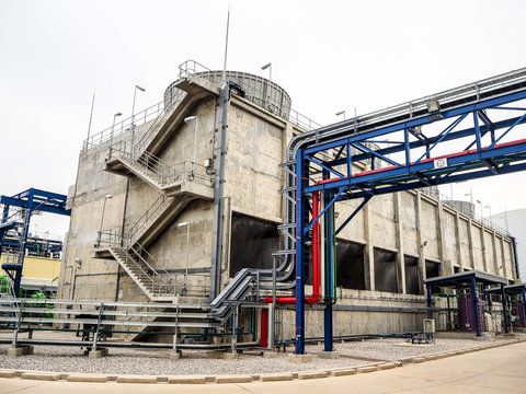 Cooling tower systems for supply cooling water to mature equipment in power plant about industrial concept.