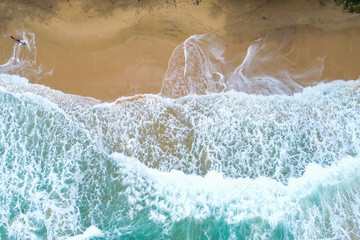 Beach aerial view with turquoise sea wave