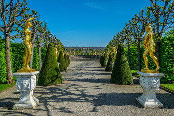 Golden statues in gardens of Herrenhausen palace in Hannover, Germany