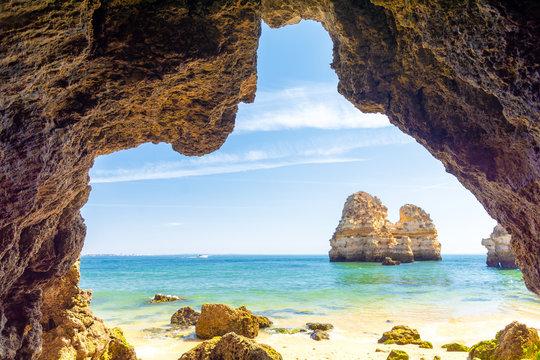 rocky arch on sandy beach Praia do Camilo in Lagos, Algarve, Portugal
