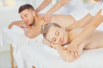 Couple enjoying massage body at the spa center