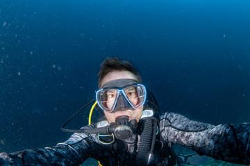 Wall Mural - Scuba diver underwater selfie portrait in the ocean