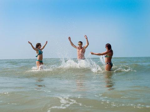 Guy and girls fun splashing in the sea