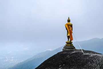 Buddha statue standing on the mountain view point